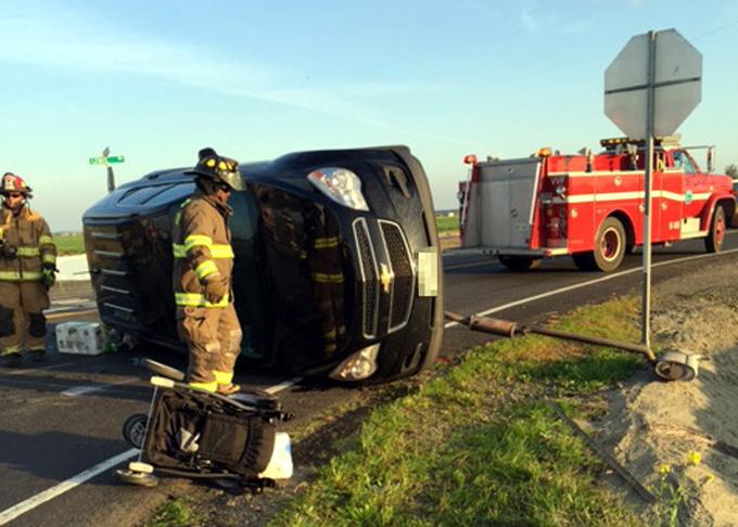 Senior Airman Jeremy Derrick assists at accident scene